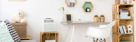 Very bright panorama of a teenagers bedroom arranged in eco-friendly style