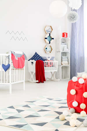 Baby Room In Marine Style With White Furniture And Beautiful Decorations  Photo