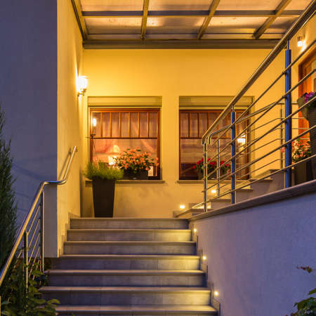 lighted: Elegant lighted outside stairs with metal handrail