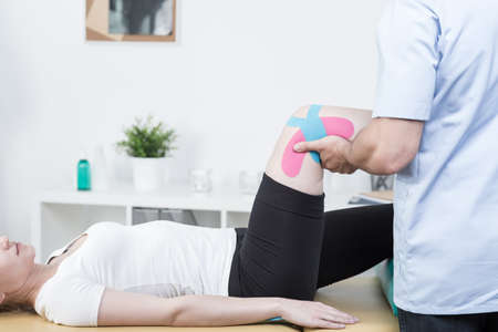 medical cabinet: Woman at physical therapists cabinet on rehabilitation Stock Photo