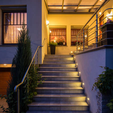 Close up of solid outside steps with lighting and railing