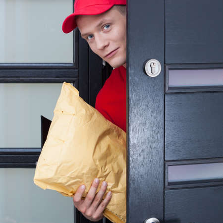 Delivery guy coming through the front door Stock Photo - 57968564