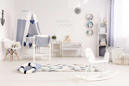 Light and spacious baby room in marine style with stylish navy decorations Stock Photo