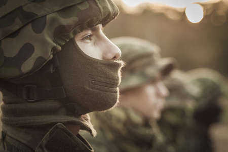 armed: Close up of a uniformed soldier standing with pride