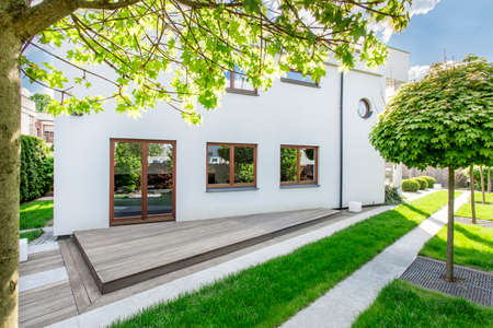 White new design home with simple backyard space