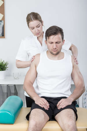 mobilization: Main with pain on his shoulder mobilization Stock Photo