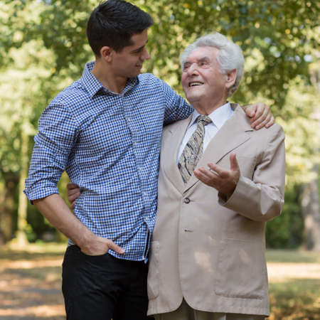senescence: Photo of rich elderly male and his private carer Stock Photo