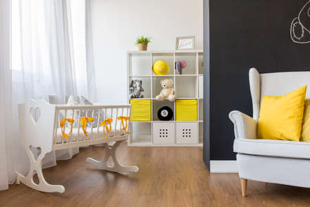 room decoration: Shot of a cozy nursery room with a blackboard wall