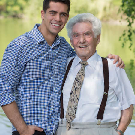 Senior grandfather and mature grandson spending time together Stock Photo