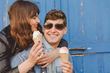 free time: Young couple is eating ice creams and spending happily their free time