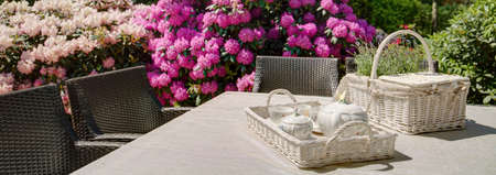 luxury apartment: Teatime in the garden  - close-up on table setting