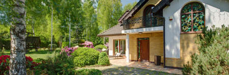 Classic detached house with big beautiful garden Stock Photo - 58219558