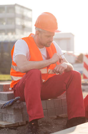 break: Man having a cigarette break on the building site