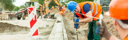 tiring: Construction workers are checking everything at the building site Stock Photo