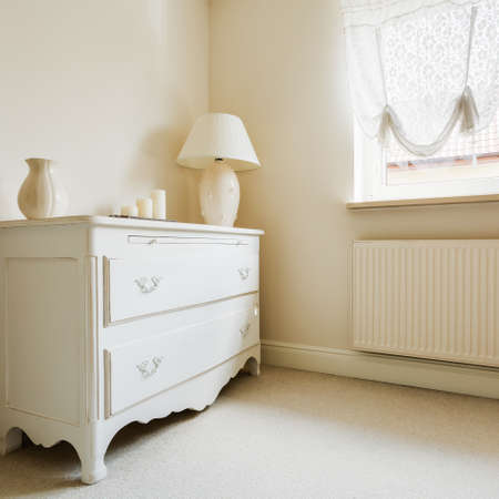 lampshades: Photo of chest of drawers in wardrobe of extravagant house Stock Photo