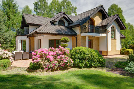 luxurious: Luxurious house with garden in the suburbs Stock Photo