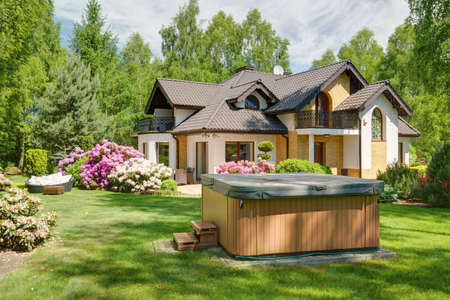 Jacuzzi in the garden of rich contemoprary house