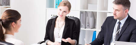 superiors: In one of the rooms of corporation is held a conversation between female employee and her superiors