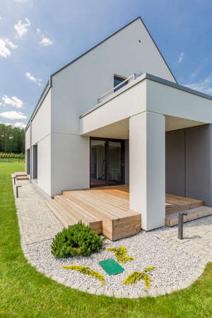 Shot of a simple white detached house