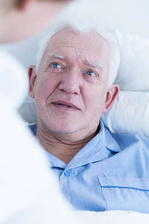 infirm: Close-up of elderly male patient lying in hospital bed
