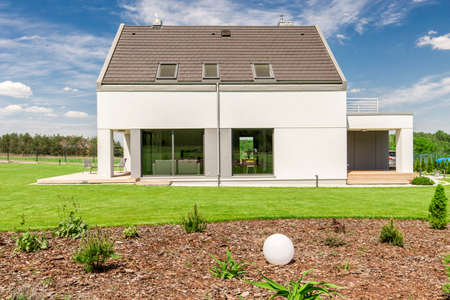 Shot of a white detached house and its garden Stock Photo