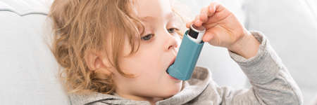 inhalation: Close-up of little asthmatic child doing inhalation therapy