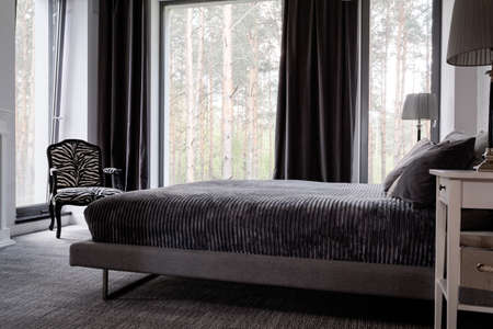 kingsize: Shot of a king-size bed in a modern grey bedroom Stock Photo