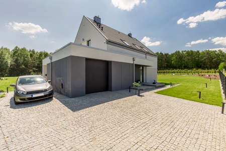 Shot of a modern detached house surrounded by forest Stock Photo