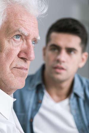 senior adult man: Annoyed senior man and his adult son Stock Photo