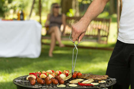 barbecuing: Cropped picture of a man barbecuing food Stock Photo