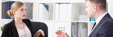 consternation: Female employee looks with horror at her angry boss