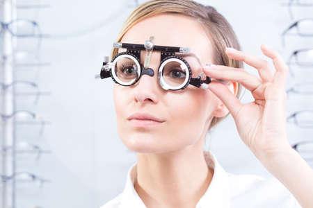 optometrist: Beautiful woman having sight test at optometrist Stock Photo