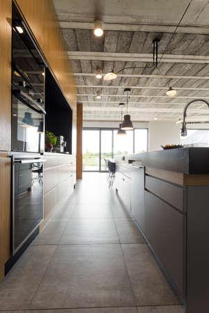Spacious open plan kitchen in an industrial design villa