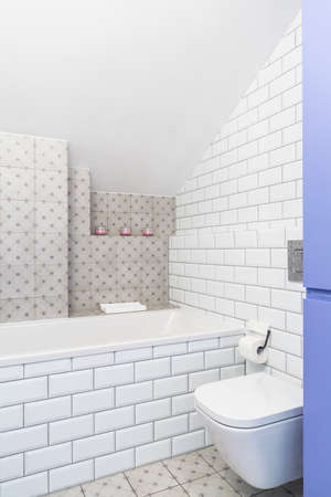 bathroom tiles: Modern bathroom with white brick effect tiles and toilet