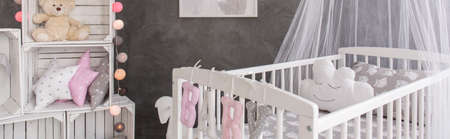 babygirl: Baby room with a simple wooden furniture, stylish decorations and cement wall design