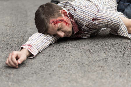 car safety: Photo of car accident victim lying on street