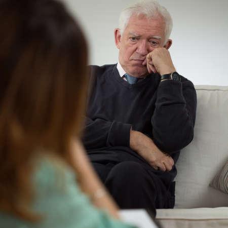 neurosis: Elderly man talking with psychotherapist