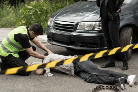 Photo of policeman on the car accident scene Stock Photo