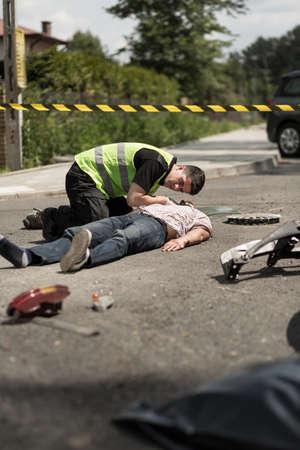 resuscitate: Photo of paramedic resuscitating injured traffic collision victim