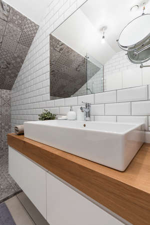 New design bathroom with white brick effect tiles, big basin and mirror