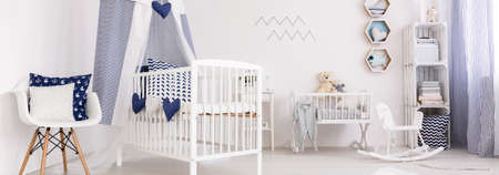 Panoramic picture of a crib in a cozy baby room Stockfoto
