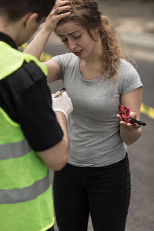 traffic police: Picture of female participant of motor vehicle collision