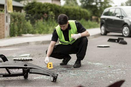 securing: Image of police officer securing car accident scene