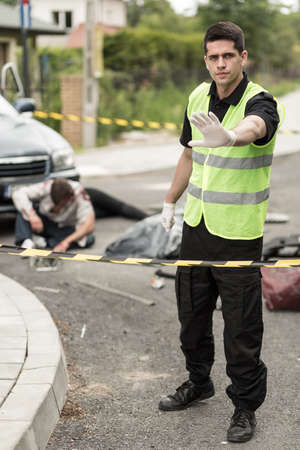 roadside assistance: Image of car accident and roadside assistance worker