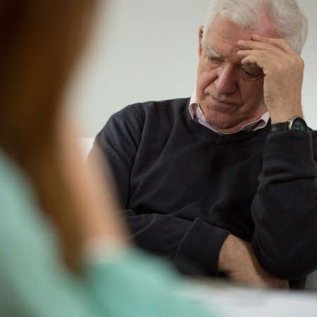 neurosis: Old man at visit in psychiatrists office