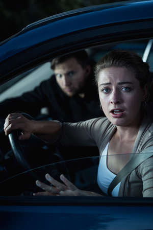 clout: Shot of a woman sitting in a car and being scared of a man looking at her