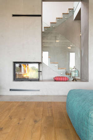 hardwood flooring: Industrial design livign room with a fireplace and hardwood flooring