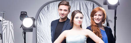 advertising agency: Creative workers of advertising agency standing in professional photo studio, panorama