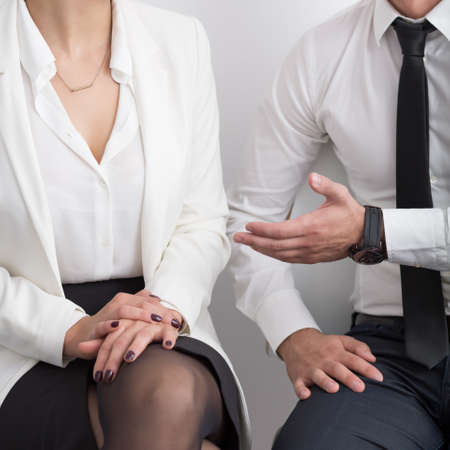 formal clothes: Businesswoman and businessman in formal clothes - square