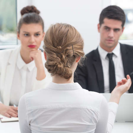 Girl talking with chief during job interview